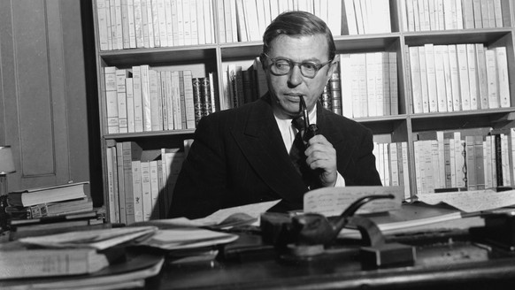 FILE - In this Nov. 28, 1948 file photo, French author and philosopher Jean-Paul Sartre sitting in his study in Paris. The Swedish Academy awarded the Nobel Prize in Literature in 1964 to Sartre