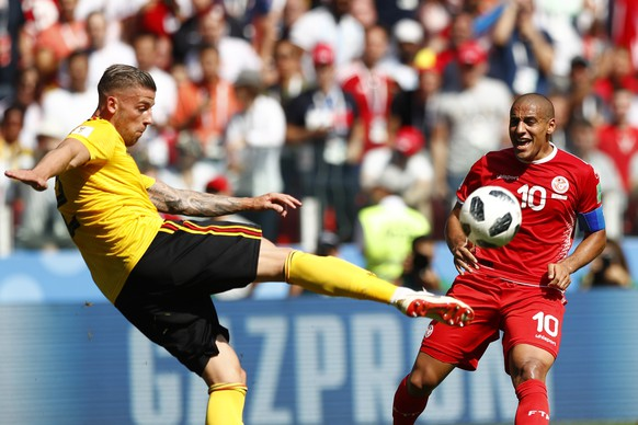 Belgium's Toby Alderweireld, left, and Tunisia's Wahbi Khazri challenge for the ball during the group G match between Belgium and Tunisia at the 2018 soccer World Cup in the Spartak Stadium in Moscow, Russia, Saturday, June 23, 2018. (AP Photo/Matthias Schrader)