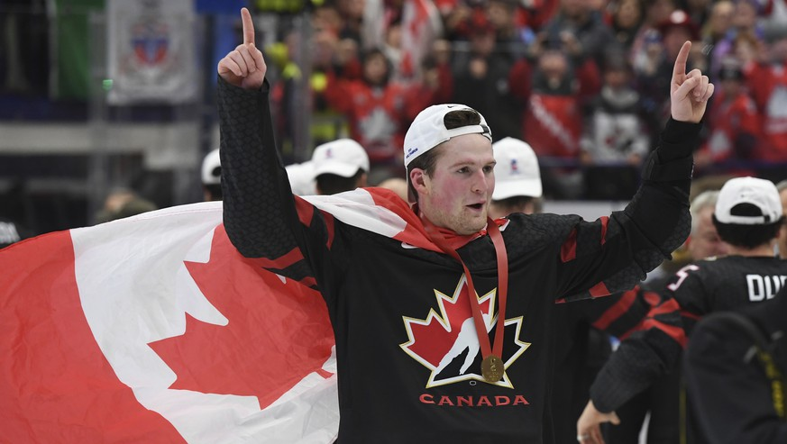 Canada's Alexis Lafreniere wears a Canadian flag as he celebrates after defeating Russia in the gold medal game at the World Junior Hockey Championships, Sunday, Jan. 5, 2020, in Ostrava, Czech Republic. (Ryan Remiorz/The Canadian Press via AP)