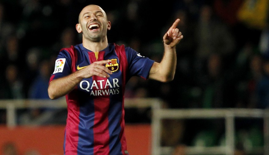 Barcelona's Javier Mascherano, from Argentina, laughs during a Spanish La Liga soccer match between Elche and Barcelona, at the Martinez Valero stadium in Elche, Spain, Saturday, Jan. 24, 2015. (AP Photo/Fernando Bustamante)