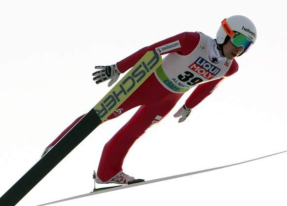 epa05183963 Simon Ammann of Switzerland is airborne during the Men's HS140 competition at the FIS Ski Jumping World Cup in Almaty, Kazakhstan, 27  February 2016.  EPA/IGOR KOVALENKO