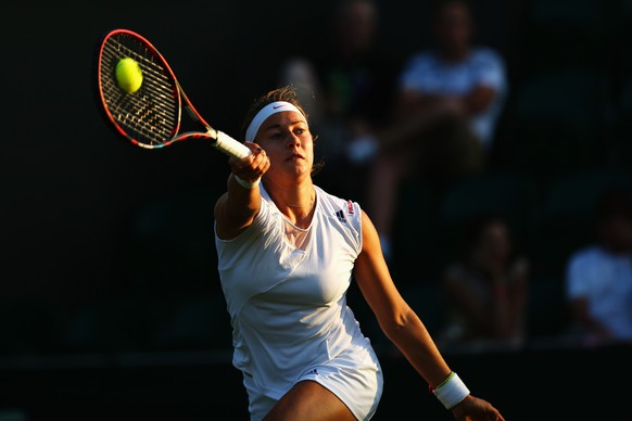 LONDON, ENGLAND - JUNE 30:  Stefanie Voegele of Switzerland in action in her Ladies Singles first round match against Madison Keys of the United States during day two of the Wimbledon Lawn Tennis Championships at the All England Lawn Tennis and Croquet Club on June 30, 2015 in London, England.  (Photo by Clive Brunskill/Getty Images)