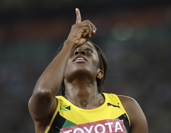 Jamaica's Danielle Williams reacts after a women's 100m hurdles semifinal at the World Athletics Championships at the Bird's Nest stadium in Beijing, Friday, Aug. 28, 2015. (AP Photo/David J. Phillip)