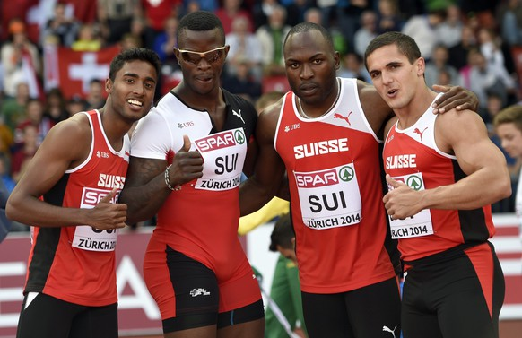 epa04356412 Switzerland's Suganthan Somasundaran, Reto Amaru Schenkel, Alex Wilson and Pascal Mancini, from left to right, reacts after setting a new swiss national record in the men's 4x100m relay round 1 race, at the fifth day of the European Athletics Championships in the Letzigrund Stadium in Zurich, Switzerland, Saturday, August 16, 2014.  EPA/JEAN-CHRISTOPHE BOTT