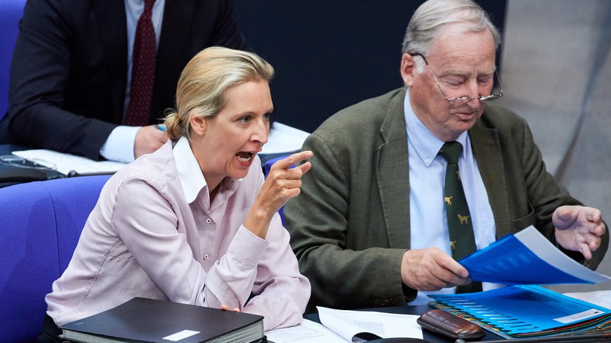 epa06741367 The co-chairpersons of the right-wing populist 'Alternative for Germany' (AfD) party's parliamentary group, Alexander Garland (R) and Alice Weidel (L) react to a speech during a session of the German 'Bundestag' parliament, in Berlin, Germany, 16 May 2018. Members of the German parliament meet to debate topics regarding the Federal Chancellory, the Foreign Office and the Defence Ministry.  EPA/HAYOUNG JEON