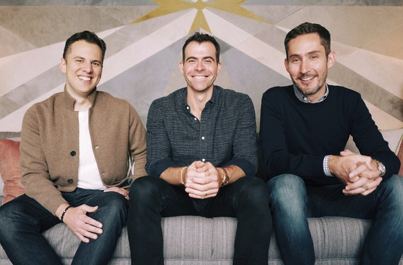 In this undated photo provided by Instagram/Facebook Inc. Adam Mosseri, center, poses for a photo with Instagram co-founders Kevin Systrom, right, and Mike Krieger. Facebook says it has named Mosseri, a 10-year veteran of the company, as the head of Instagram. (Instagram/Facebook Inc. via AP)
