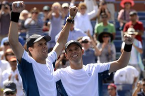 Bob(L) and Mike Bryan of the US celebrate match point against Marcel Granollers and Marc Lopez of Spain after their Men's Doubles - Final match at the USTA Billie Jean King National Tennis Center September 7, 2014 in New York.    AFP PHOTO /  TIMOTHY  A. CLARY