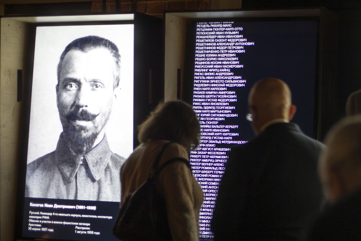 FILE  - In this Friday, Oct. 30, 2015 file photo, visitors look at an exposition at the opening of the Gulag history museum in Moscow, Russia. A museum studying the history of Soviet prison camps said Friday, June 8, 2018 that it has discovered a recent, secret Russian order instructing officials to destroy data on prisoners. Up to 17 million people were sent to the Gulag, the notorious Soviet prison camp system, in the 1930s and 1940s, and at least 5 million of them were convicted on false testimony. The prison population in the sprawling labor camps peaked at 2 million people. (AP Photo/Alexander Zemlianichenko, File)