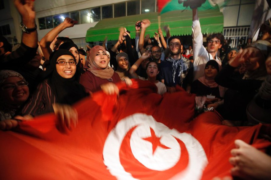 Supporters of the Islamist Ennahda movement celebrate outside Ennahda's headquarters in Tunis October 25, 2011. The party said on Tuesday it had won more than 40 percent of seats in Sunday's election, pledging to continue democracy after the first vote that resulted from the