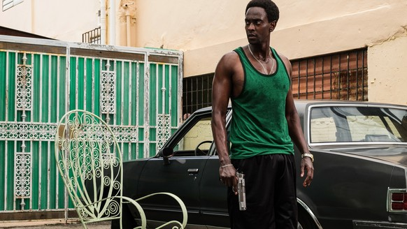 "In this image provided by Crackle, Edi Gathegi plays Haitian-American gangster Ronald Dacey in the new Crackle techno-thriller ""StartUp."" It premieres Tuesday, Sept. 6, 2016, on the streaming service. (Francisco Roman/Crackle via AP)"