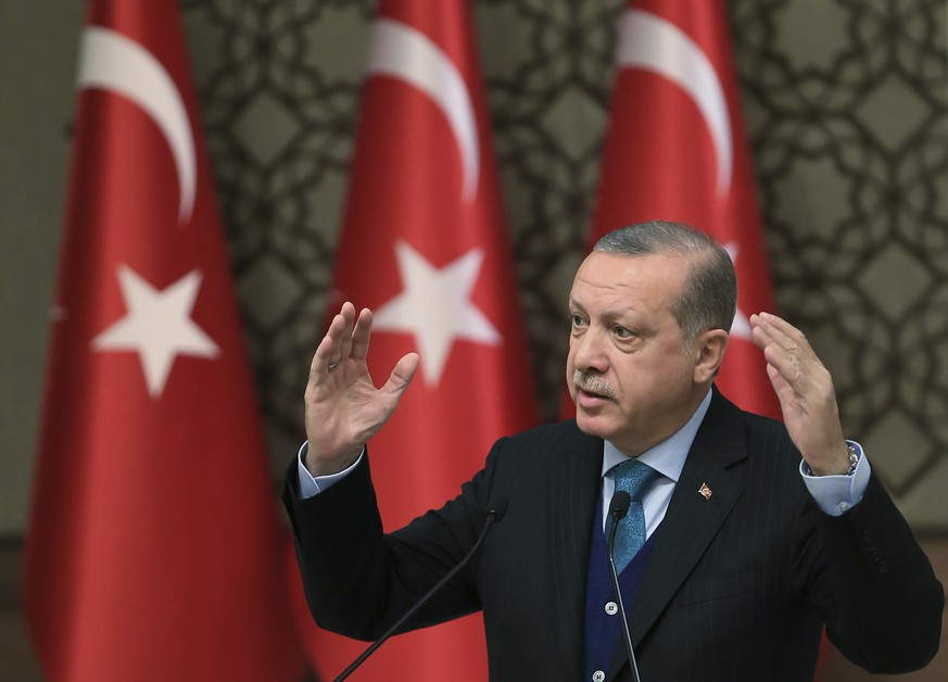 Turkey's President Recep Tayyip Erdogan, gestures as he delivers a speech at an event in Ankara, Turkey, Tuesday, Dec. 12, 2017. Leaders and high-ranking officials of Muslim countries will meet Wednesday Dec. 13, in Istanbul for an extraordinary summit to discuss the U.S. recognition of Jerusalem as Israel's capital. Erdogan has been vehemently critical of the U.S. move and said the leaders would relay a