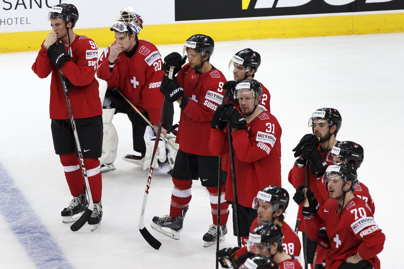 Switzerland's players, from left, Roman Josi, goaltender Reto Berra, Thomas Ruefenacht, Luca Cunti, Mathias Seger, Kevin Romy, Etienne Froidevaux, Denis Hollenstein and other players look disappointed after losing against Belarus after the 2014 IIHF Ice Hockey World Championships preliminary round game Switzerland vs Belarus, at the Minsk Arena, in Minsk, Belarus, Monday, May 12, 2014. (KEYSTONE/Salvatore Di Nolfi)