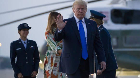 President Donald Trump, with first lady Melania Trump, waves as they walk to Air Force One as they depart Sunday, June 2, 2019, at Andrews Air Force Base, Md. Trump is going to London, France and Ireland. (AP Photo/Alex Brandon)