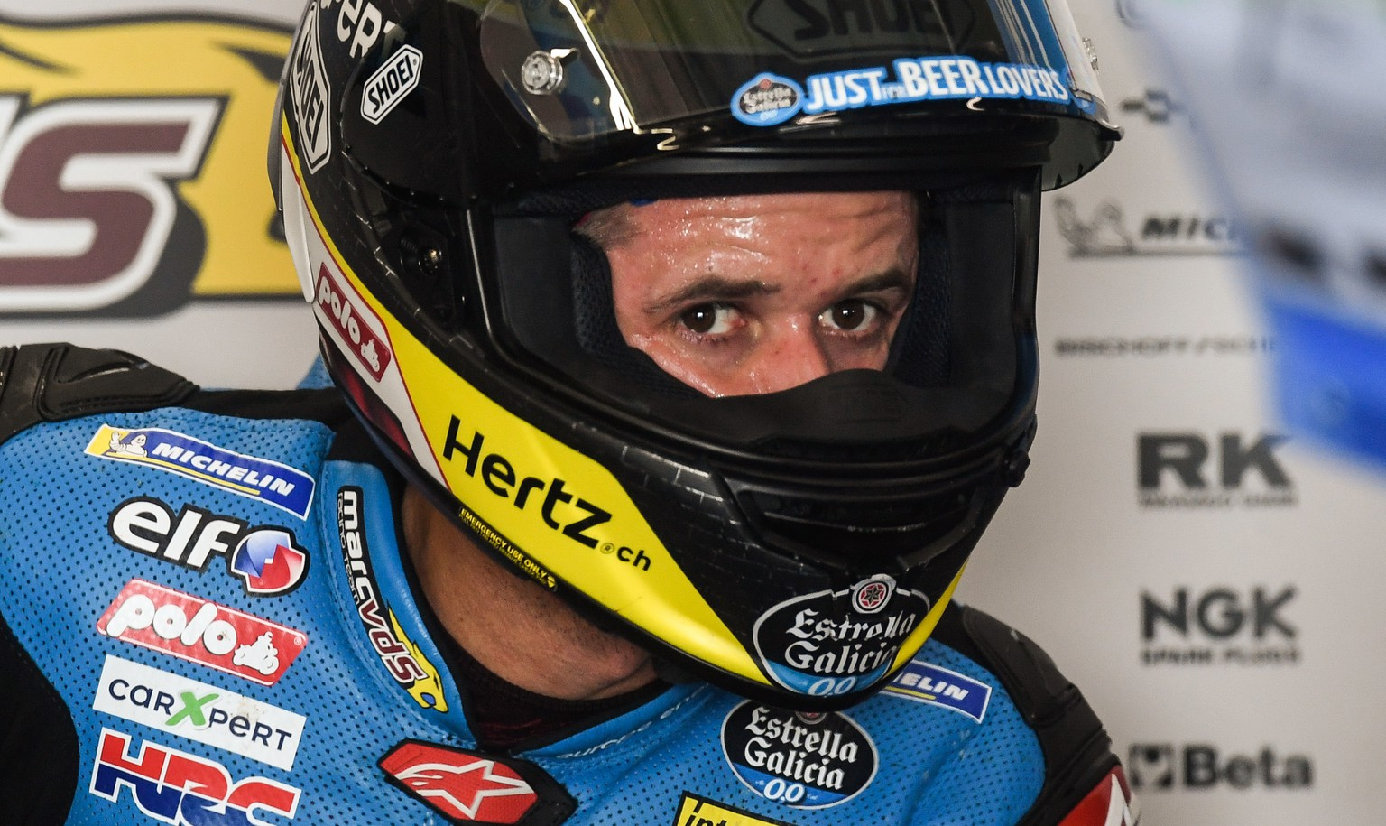 epa06887478 Swiss Moto GP rider Thomas Luethi of EG 0,0 Marc VDS  in his team's box during the free practice session of the motorcycling Grand Prix of Germany at the Sachsenring racing circuit in Hohenstein-Ernstthal, Germany, 14 July 2018. The Motorcycling Grand Prix of Germany takes place on 15 July.  EPA/FILIP SINGER