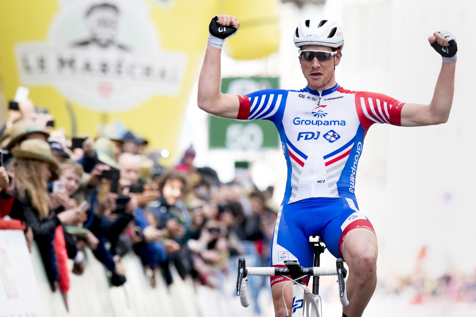 Stefan Kueng from Switzerland of team Groupama-FDJ raises his arms after crossing the finish line to win the second stage, a 174,4 km race between Le Locle and Morges at the 73th Tour de Romandie UCI ProTour cycling race in Morges, Switzerland, Thursday, May 2, 2019. (KEYSTONE/Laurent Gillieron)