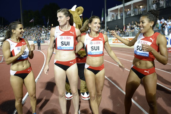 "Switzerland's Marisa Lavanchy, Lea Sprunger, Ellen Sprunger and Mujinga Kambundji, from left to right, react after the women's 4x100m relay race ""UBS Trophy"" at the Athletissima IAAF Diamond League athletics meeting in the Stade Olympique de la Pontaise in Lausanne, Switzerland, Thursday, July 3, 2014. (KEYSTONE/Jean-Christophe Bott)"