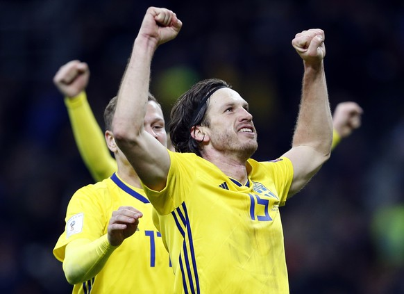 Sweden's Gustav Svensson celebrates at the end of the World Cup qualifying play-off second leg soccer match between Italy and Sweden, at the Milan San Siro stadium, Italy, Monday, Nov. 13, 2017. Four-time champion Italy has failed to qualify for World Cup; Sweden advances with 1-0 aggregate win in playoff. (AP Photo/Antonio Calanni)