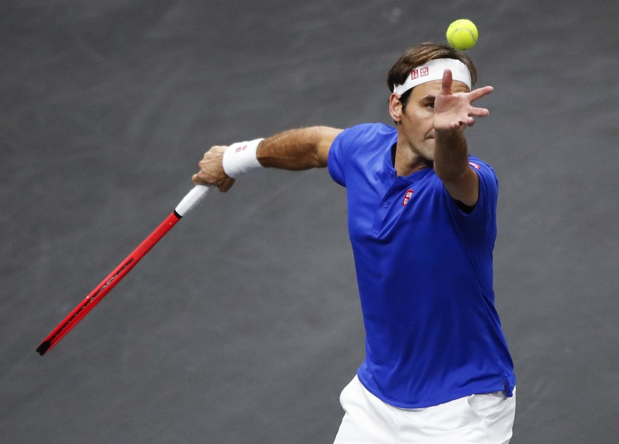 Team Europe's Roger Federer serves against Team World's Nick Kyrgios at the Laver Cup tennis event, Saturday, Sept. 22, 2018, in Chicago. (AP Photo/Kamil Krzaczynski)