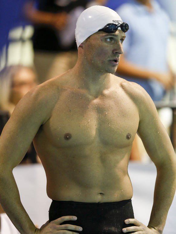 Ryan Lochte stands poolside before the start of the 200 meter backstroke at the Arena Pro Swim Series meet in Charlotte, N.C, Sunday, May 17, 2015. Lochte finished third with a time of 1:58.96. (AP Photo/Nell Redmond)