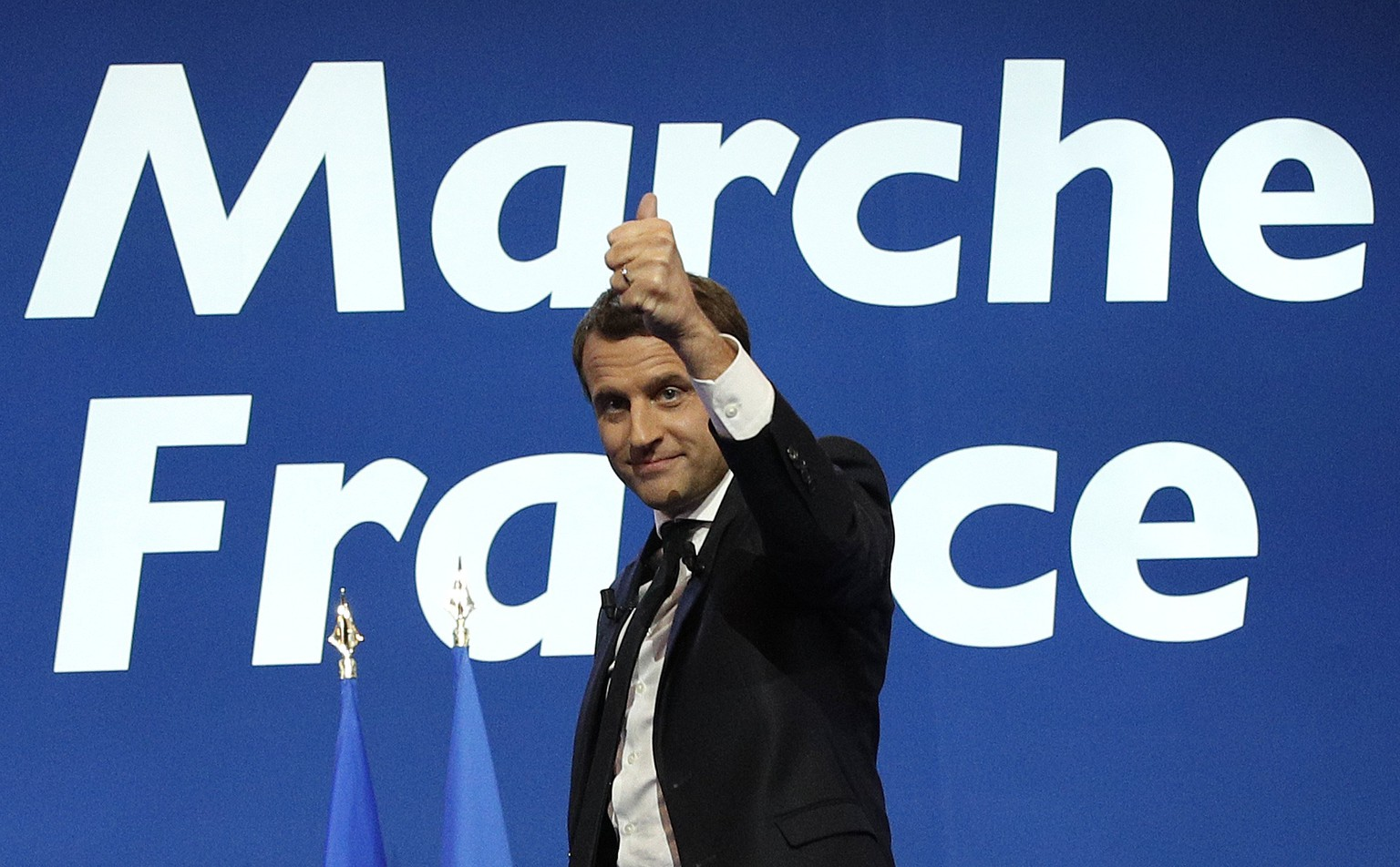 epa05924569 French presidential election candidate for the 'En Marche!' (Onwards!) political movement, Emmanuel Macron celebrates after the first round of the French presidential elections in Paris, France, 23 April 2017. Media reports that polling agencies projections place Le-Pen and centrist presidential candidate Emmanuel Macron in the lead positions for the vote. France will hold the second round of the presidential elections on 07 May 2017.  EPA/YOAN VALAT