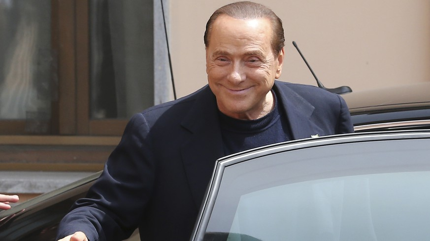 Former Italian Premier Silvio Berlusconi smiles as he leaves the