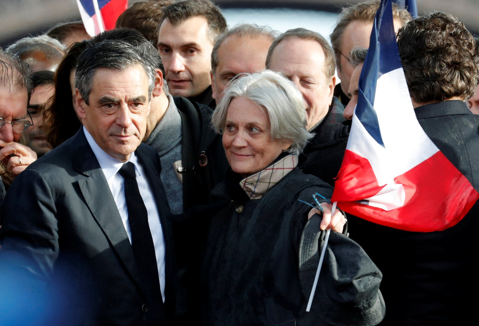 Francois Fillon, former French prime minister, member of The Republicans political party and 2017 presidential election candidate of the French centre-right and his wife Penelope (R) attend a meeting at the Trocadero square across from the Eiffel Tower in Paris, France, March 5, 2017. REUTERS/Philippe Wojazer
