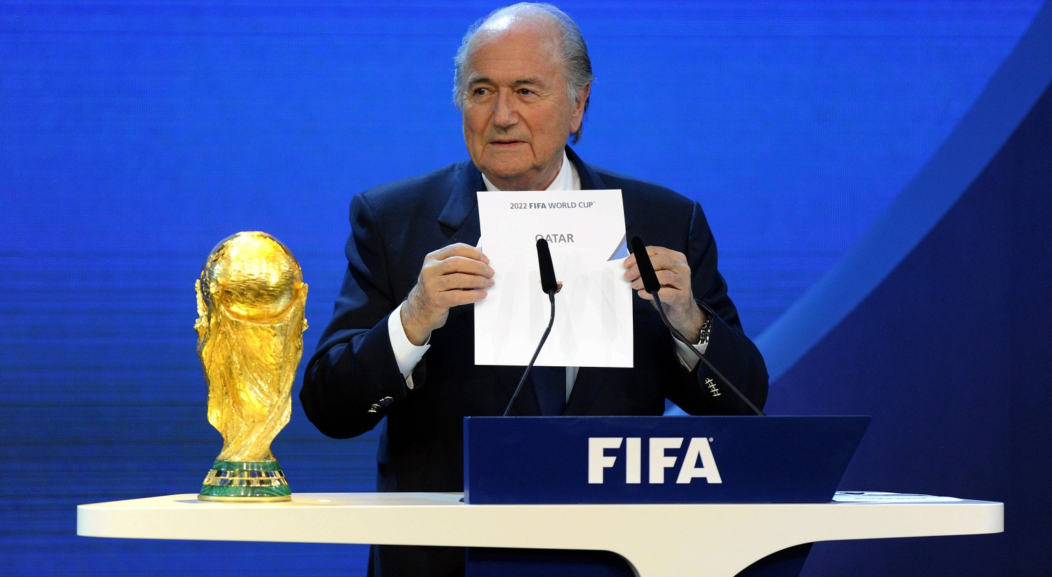 FILE - In this Dec. 2, 2010 file picture FIFA President Joseph S. Blatter announces that Qatar will be hosting the 2022 Soccer World Cup, during the FIFA  2018 and 2022 World Cup Bid Announcement in Zurich, Switzerland. A FIFA task force on Tuesday, Feb. 24, 2015 recommended playing the 2022 World Cup in November-December to avoid the summer heat in Qatar. The plan must be approved by the FIFA executive committee, chaired by Blatter, at a March 19-20, 2015 meeting in Zurich. (AP Photo/Keystone/Walter Bieri, File)