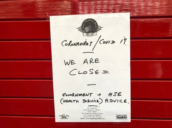 A sign on the door of The Temple Bar, as pubs and clubs in Irish tourist hotspot Temple Bar closed with immediate effect amid coronavirus fears, in Dublin, Ireland, Sunday March 15, 2020. For most people, the new coronavirus causes only mild or moderate symptoms. For some, it can cause more severe illness, especially in older adults and people with existing health problems. (Aine McMahon/PA via AP)