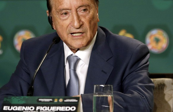 FILE - In this May 1, 2014 file photo Eugenio Figueredo, president of CONMEBOL, the South America soccer confederation, gives a news conference in Bal Harbour, Florida. Figueredo, one of several soccer officials detained by Swiss police on May 27, 2015 at the request of U.S. authorities, had nine of his properties in Uruguay seized by authorities, according to Uruguay's organized crime prosecutor Juan Gomez on Wednesday, June 24, 2015. (AP Photo/Alan Diaz, File)