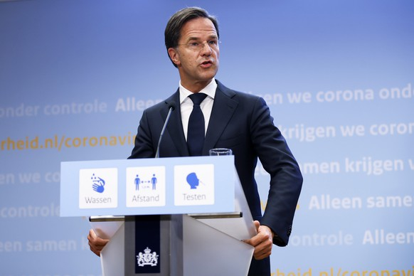 epa09283641 Dutch Outgoing Prime Minister Mark Rutte during a press conference in the Hague, the Netherlands, 18 June 2021. The cabinet announces accelerated relaxation of the coronavirus measures.  EPA/REMKO DE WAAL