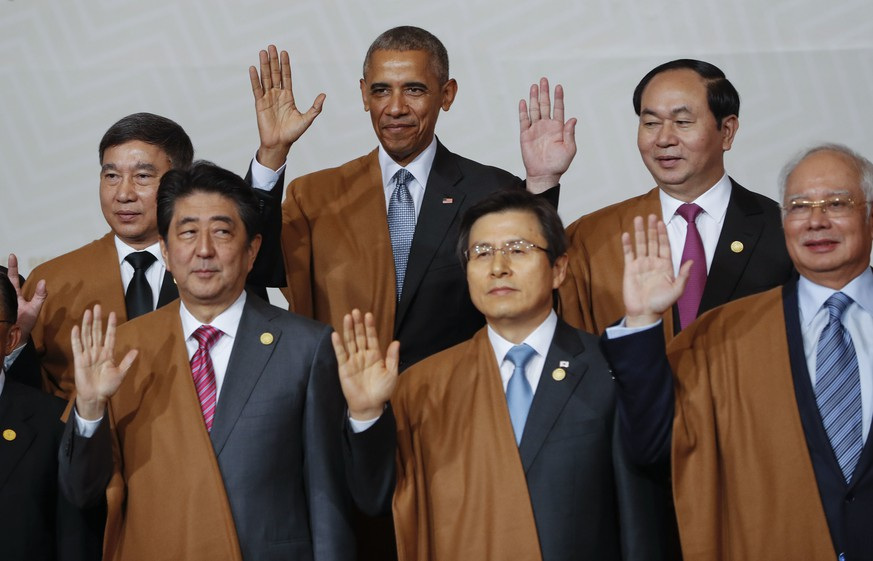 U.S. President Barack Obama, background center, is joined byTaiwan 's special APEC envoy James Soong, from left, Japan's Prime Minister Shinzo Abe, South Korea's Prime Minister Hwang Kyo-ahn, Vietnam's President Tran Dai Quang and Malaysia's Prime Minister Najib Razak of the Asia-Pacific Economic Cooperation (APEC), for a group photo in Lima, Peru, Sunday, Nov. 20, 2016.  (AP Photo/Pablo Martinez Monsivais)