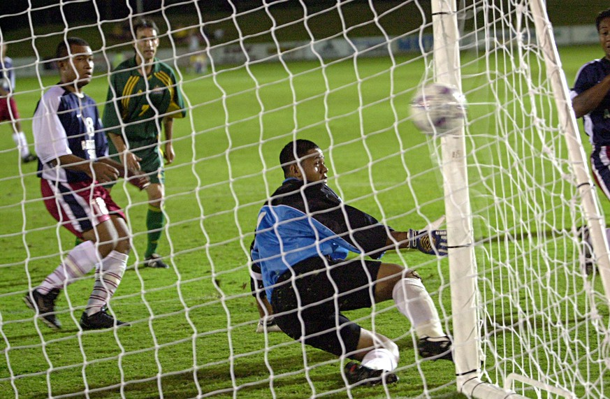 11 Apr 2001:  Aurelio Vidmar #7 of the Socceroos gets a goal past Nicky Salapu #1 of American Samoa  during the Oceania group one World Cup qualifier match between Australia and American Samoa played at the Coffs Harbour International Sports Stadium in Coffs Harbour, Australia. DIGITAL IMAGE. Mandatory Credit: Darren England/ALLSPORT
