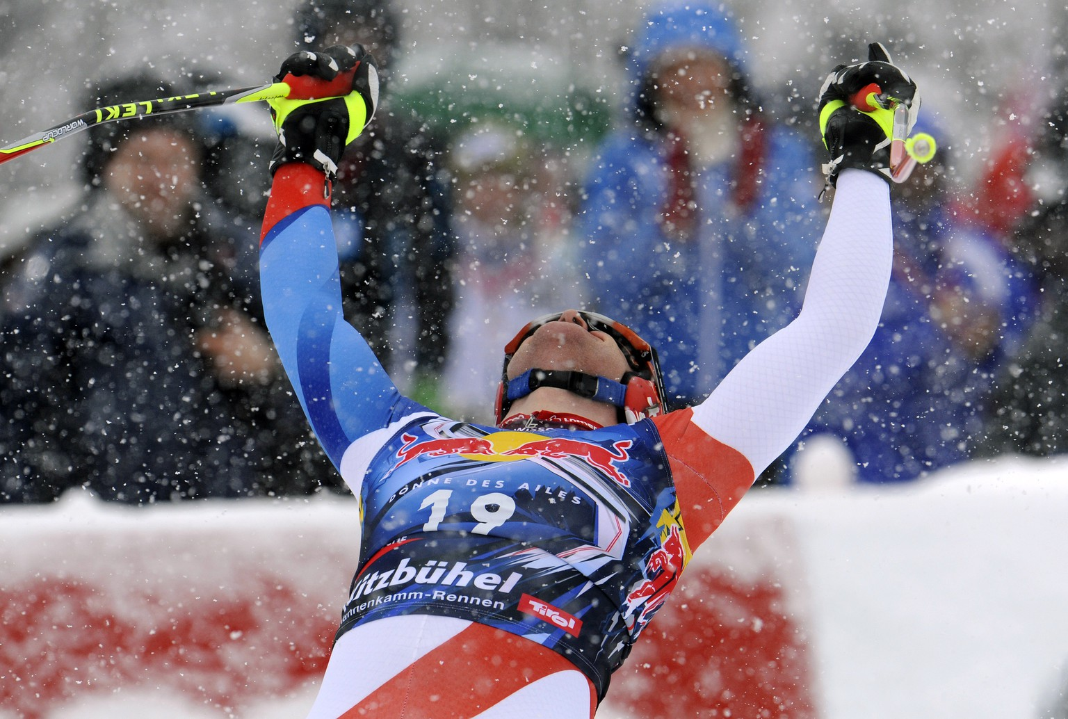 Didier Cuche, of Switzerland, celebrates in the finish area after winning an alpine ski, men's World Cup downhill, in Kitzbuehel, Austria, Saturday, Jan. 21, 2012. Didier Cuche won the classic World Cup downhill on the Streif course for a record fifth time on Saturday. (AP Photo/Giovanni Auletta)