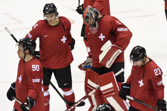 From left, Switzerland's defender Roman Josi, Switzerland's forward Roman Wick, Switzerland's goaltender Jonas Hiller and Switzerland's forward Simon Bodenmann are desapointed after the men's ice hockey qualification play-offs between Switzerland and Latvia at the XXII Winter Olympics 2014 Sochi in Sochi, Russia, on Tuesday, February 18, 2014. (KEYSTONE/Laurent Gillieron)