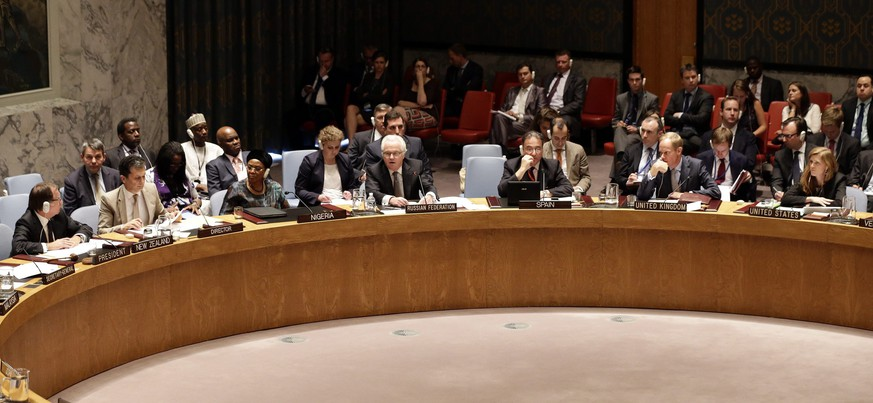 epa04865588 Vitaly Churkin, Russian Ambassador to the United Nations (C) addresses the United Nations Security Council (UNSC) during a vote on the situation in the Ukraine and on Malaysia Airlines Flight 17 at the UN headquarters in New York, USA, 29 July 2015. Russia vetoed a UN Security Council resolution aiming to set up an international criminal tribunal over the downing of Malaysian Airlines flight MH17 over Ukraine a year ago.  EPA/JASON SZENES