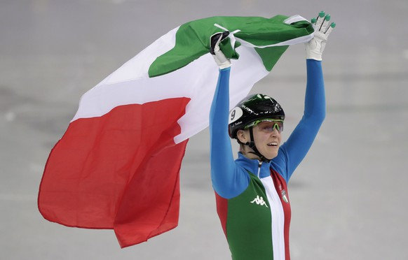 AriannaFontana of Italy celebrates after winning the ladies' 500 meters short track speedskating final in the Gangneung Ice Arena at the 2018 Winter Olympics in Gangneung, South Korea, Tuesday, Feb. 13, 2018. (AP Photo/Julie Jacobson)