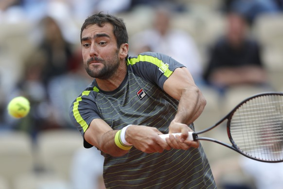 Croatia's Marin Cilic plays a shot against Bulgaria's Grigor Dimitrov during their second round match of the French Open tennis tournament at the Roland Garros stadium in Paris, Wednesday, May 29, 2019. (AP Photo/Pavel Golovkin)