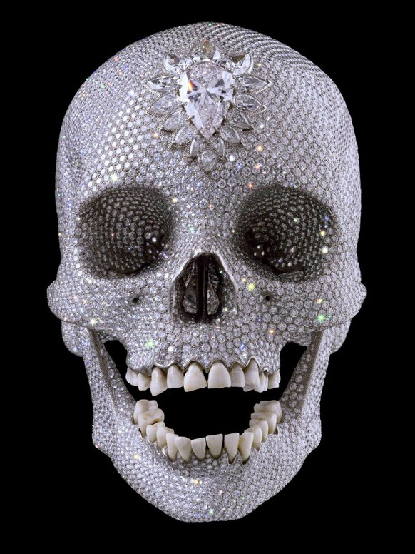 A gallery handout picture supplied 06 June 2007 shows Damien Hirst's Diamond skull on display at the White Cube gallery in London 03 June 2007. The 50 million euros sculpture, that for most of its short existence has languished unseen in a secret high-security vault been deemed too costly to go on show, will be on exhibit at the Palazzo Vecchio in Florence, Italy, for the next five months. Three armed guards will be in attendance 24 hours a day to keep an eye on this controversial platinum-plated, diamond-encrusted human skull.  EPA/WHITE CUBE HANDOUT  EDITORIAL USE ONLY/NO SALES