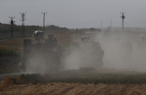 A convoy of Turkish forces' trucks transporting tanks is driven towards the border with Syria in Sanliurfa province, southeastern Turkey, Saturday, Oct. 12, 2019. Turkey says its military offensive has taken central Ras al-Ayn, a key border town in northeastern Syria, and its most significant gain since its cross-border operation began against Syrian Kurdish fighters began. (AP Photo/Lefteris Pitarakis)