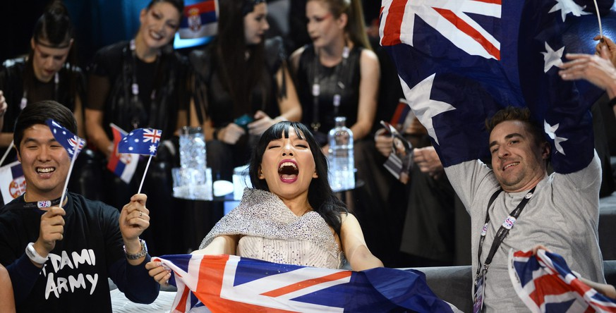 epa05302678 Australia's Dami Im (C) and her team celebrate in the Green Room during the Second Semi-Final of the 61st annual Eurovision Song Contest (ESC) at the Ericsson Globe Arena in Stockholm, Sweden, 12 May 2016. The event's grand final takes place on 14 May.  EPA/MAJA SUSLIN SWEDEN OUT