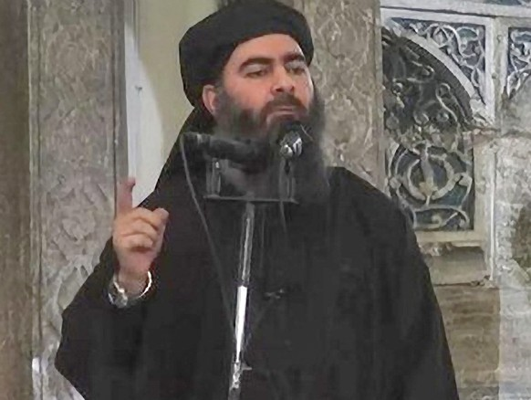epa04482235 (FILE) A file frame from video released by the Islamic State (IS) purportedly shows the caliph of the self-proclaimed Islamic State, Abu Bakr al-Baghdadi, giving a speech in an unknown location. News reports said on 08 November 2014 airstrikes took place by the US on a gathering of Islamic State commanders near Mosul. The strikes destroyed a convoy of 10 armed trucks, Colonel Patrick Ryder, a spokesman for Central Command, reported. But Ryder could not confirm whether Islamic State leader Abu Bakr al-Baghdadi was among those present in the convoy.  EPA/ISLAMIC STATE VIDEO / HANDOUT  HANDOUT EDITORIAL USE ONLY/NO SALES *** Local Caption *** 51550521