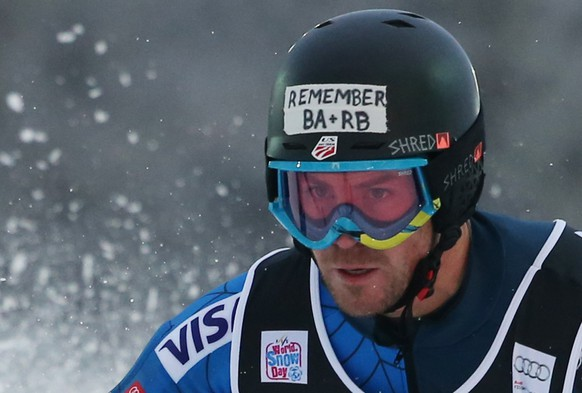 ALTERNATIVE CROP OF ZAG116 - David Chodounsky, of the U.S., wears a black armband and a sticker on his helmet bearing the initials of the two teammates Ronnie Berlack, and Bryce Astleof as he competes during an alpine ski, men's World Cup slalom in Sljeme, Zagreb, Croatia, Tuesday, Jan. 6, 2015. U. S. Ski Team athletes competing at a World Cup slalom race in Croatia have joined in the mourning of two junior members who were killed in an avalanche in Austria. The seven starters for the United States, including Olympic giant slalom champion Ted Ligety, have worn black armbands during the race. The American flag in the finish area will by flying at half-staff. The International Ski Federation says a 30-second moment of silence will be held before the race starts at 3:05 p.m. (1405 GMT). Development team members Ronnie Berlack, 20, and Bryce Astle, 19, died Monday in the incident near the Rettenbach glacier in the mountains over Soelden, the U.S. Ski Team's European training base since 2011. (AP Photo/Giovanni Auletta)