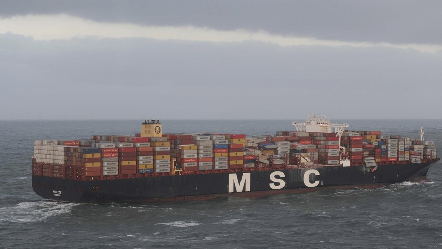 Aerial photo provided by the Central Command for Maritime Emergencies Germany shows container vessel MSC ZOE near the German North Sea island of Borkum Wednesday, Jan. 2, 2019. The Dutch coast guard said that along with light bulbs, toys and flat screens, some of the containers carried closed-off barrels of an organic peroxide, a flammable and highly toxic compound. The container ship is suspected to have lost the cargo during an overnight storm in waters off the coastal border between Germany and the Netherlands. (Central Command for Maritime Emergencies Germany/dpa via AP)