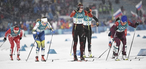 epa06520667 Laurien van der Graff of Switzerland (C) in action during the Women's Cross Country Sprint Classic Quarterfinals at the Alpensia Cross Country Centre during the PyeongChang 2018 Olympic Games, South Korea, 13 February 2018.  EPA/FILIP SINGER