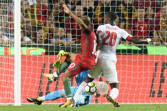 Switzerland's Johan Djourou, right, puts an own goal to 1:0 next to his goalkeeper Yann Sommer, left, and against Portugal's Joao Mario during the 2018 Fifa World Cup Russia group B qualification soccer match between Portugal and Switzerland at the Estadio da Luz stadium, in Lisbon, Portugal, Tuesday, October 10, 2017. (KEYSTONE/Laurent Gillieron)