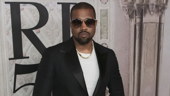 FILE - In this Sept. 7, 2018, file photo, Kanye West attends the Ralph Lauren 50th Anniversary Event held at Bethesda Terrace in Central Park during New York Fashion Week in New York.  West appeared to reignite a feud with the fellow rapper in a series of tweets on Thursday, Dec. 13, 2018,  in which he claimed Drake had called trying to threaten him.   (Photo by Brent N. Clarke/Invision/AP, File)