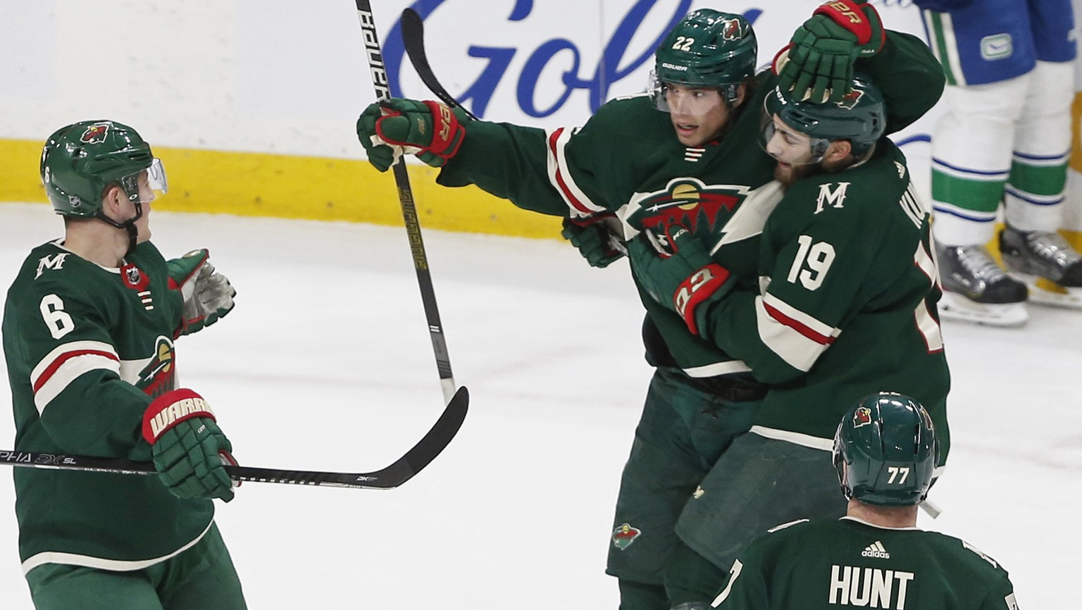 Minnesota Wild's Kevin Fiala, top left, is congratulated by teammates after his power-play goal against the Vancouver Canucks during the first period of an NHL hockey game Thursday, Feb. 6, 2020, in St. Paul, Minn. (AP Photo/Jim Mone) Kevin Fiala