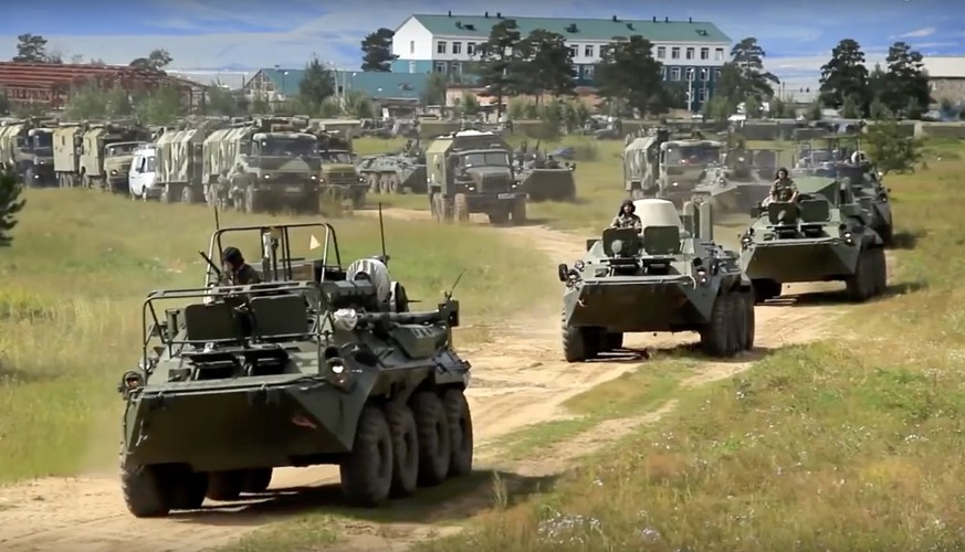 In this frame grab provided by Russian Defense Ministry Press Service on Tuesday, Sept. 11, 2018, Russian armored personnel carriers roll during the military exercises in the Chita region, Eastern Siberia, during the Vostok 2018 exercises in Russia. Russia's military chief of staff says that the military exercises expected to be the biggest in three decades, will involve nearly 300,000 troops. (Russian Defense Ministry Press Service pool photo via AP)