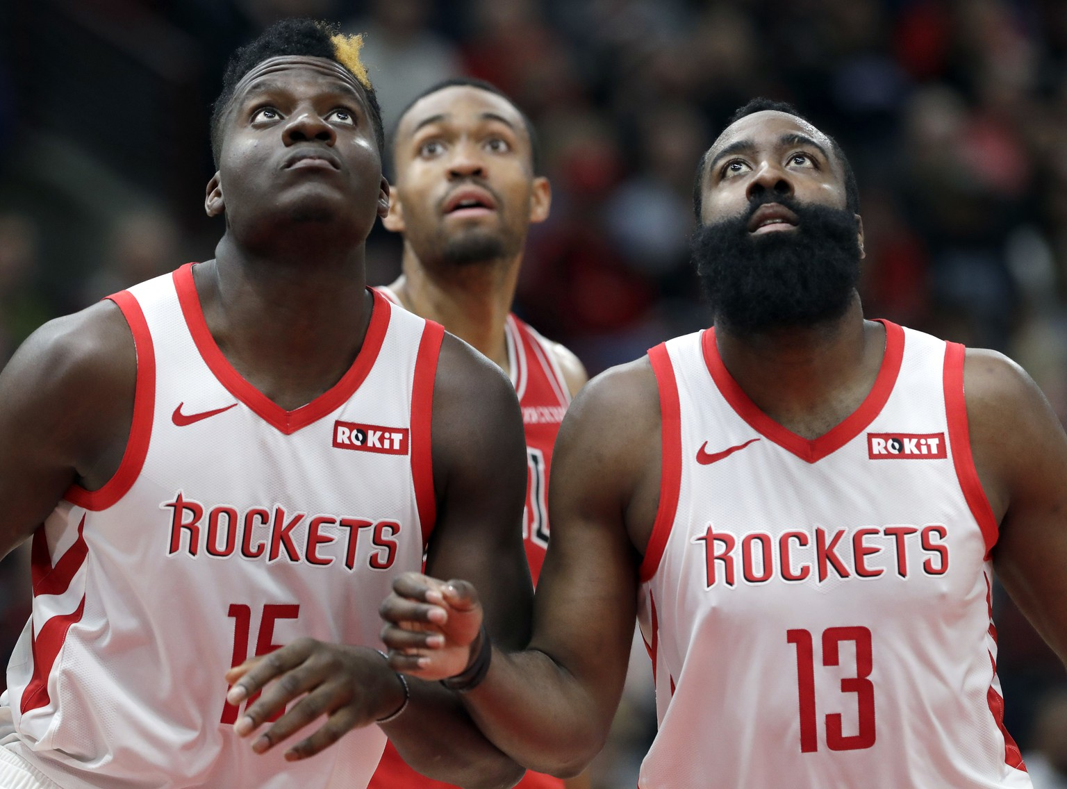 Houston Rockets center Clint Capela, left, and guard James Harden watch the ball during the second half of an NBA basketball game against the Chicago Bulls, Saturday, Nov. 3, 2018, in Chicago. (AP Photo/Nam Y. Huh)