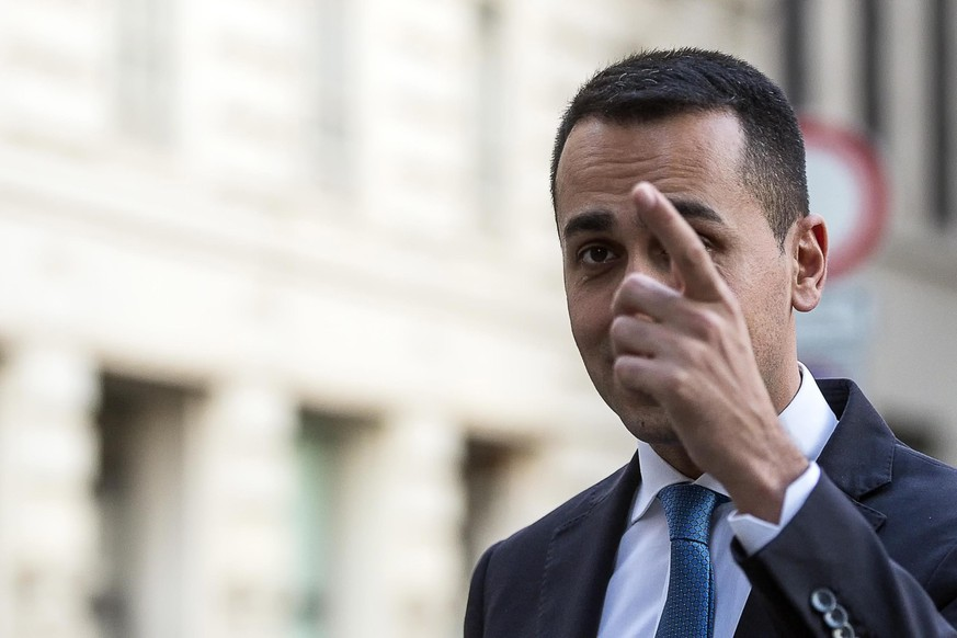 epa06763663 Five-Star Movement (M5S) leader Luigi Di Maio leaves Lower House in Rome, Italy, 25 May 2018. Italian Premier designate Giuseppe Conte met the head of the 5-star Movement (M5S) Luigi Di Maio and the League chief Matteo Salvini in the Lower House, according to reports from M5S sources.  EPA/ANGELO CARCONI